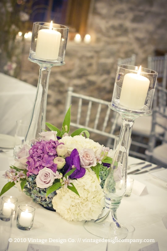 Wedding Reception Centerpieces with Glass Candlesticks at Vineland Estates Winery