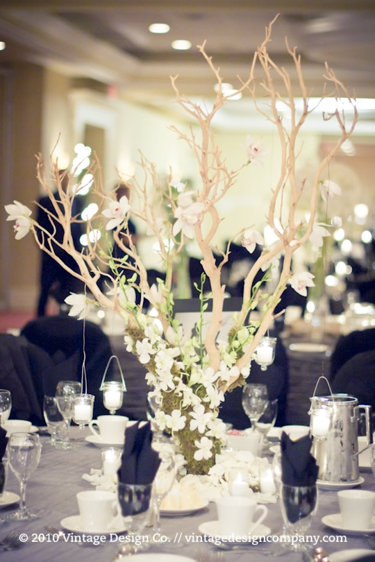 Manzanita branch wedding reception flowers
