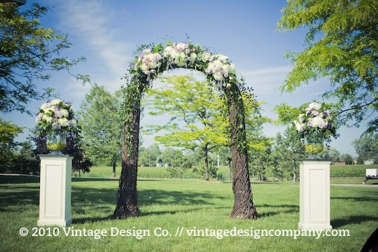 Outdoor Winery Wedding Ceremony with Grapevine Arbour