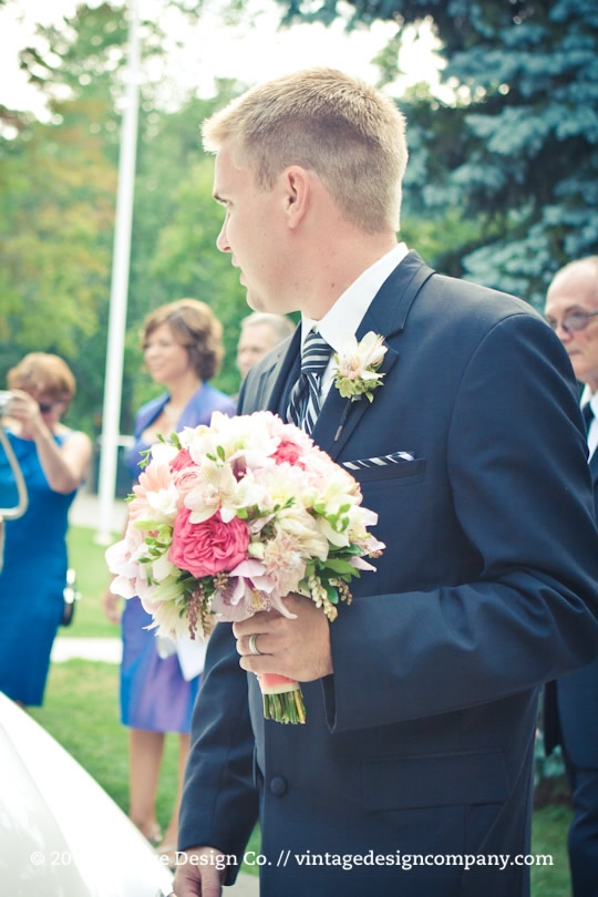 Vintage Design Co. // Groom carrying bride's bouquet