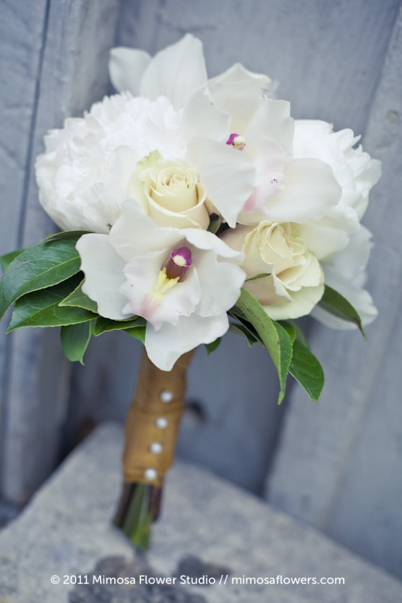 Orchid in Bridesmaid's Bouquet with Gold Ribbon