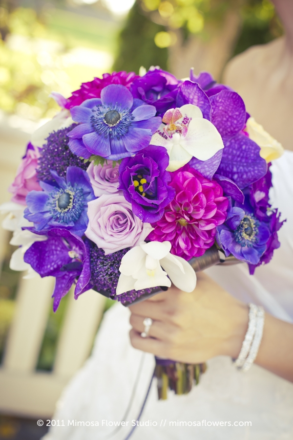 Purple Bride's Bouquet against a white dress