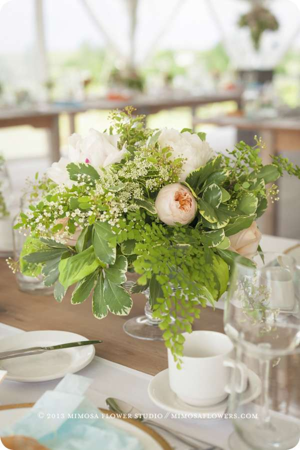 Floral centerpiece at outdoor winery wedding at Ravine Vineyard in Niagara on the Lake