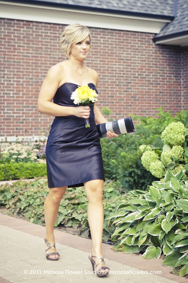 Bridemaid in black dress with yellow and white bouquet - 1