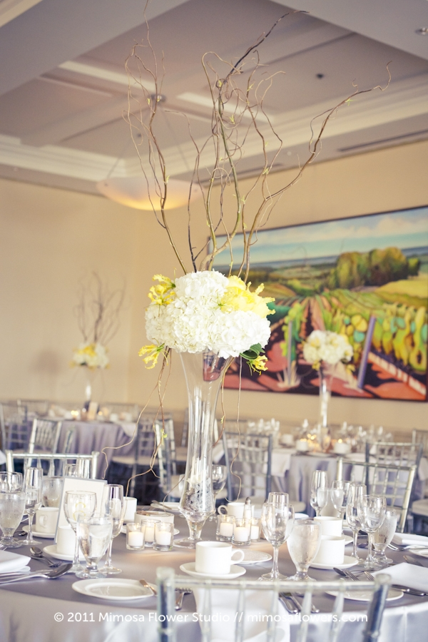 Yellow and white reception flowers with curly willow at Burlington Golf and Country Club