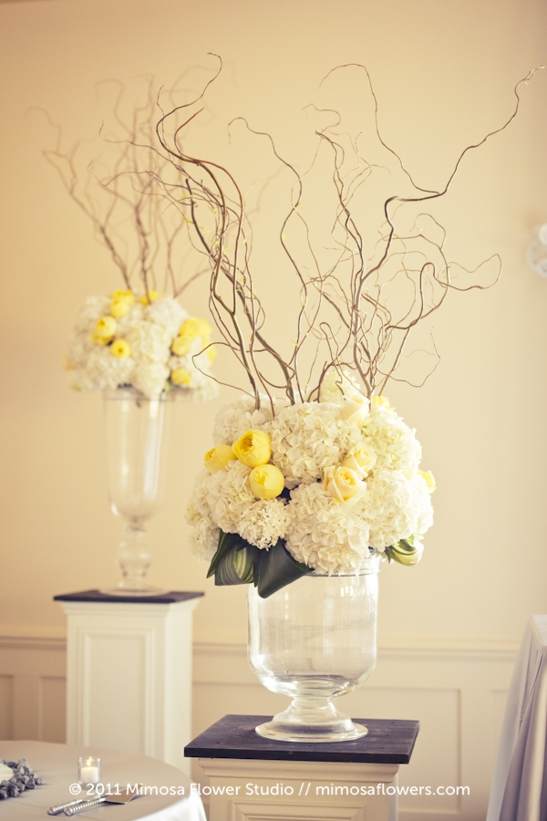 Large floral arrangements flanking the head table