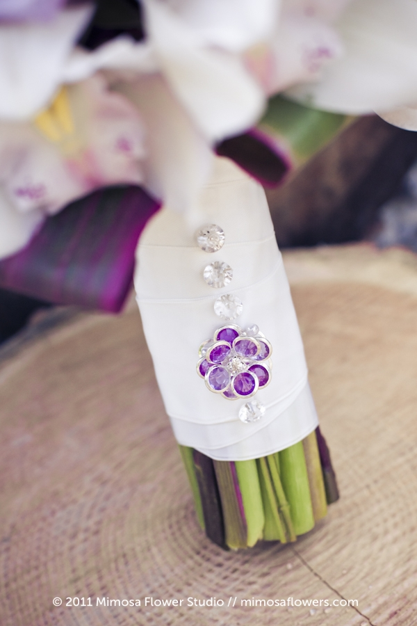Purple jewel on bridal bouquet stem