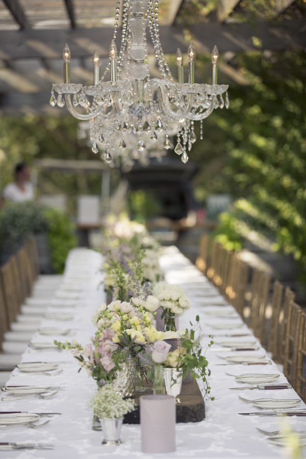 Crystal Chandelier Wedding Reception Communal Table Outdoor