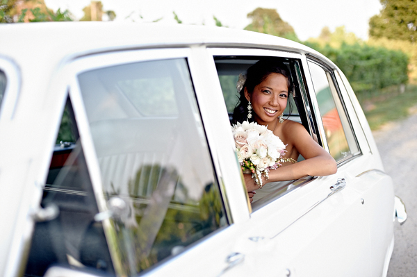 Bride in white Rolls Royce for wedding