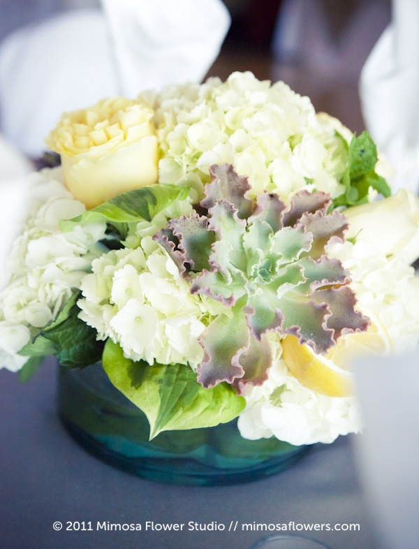 Full floral wedding centerpiece with succulent