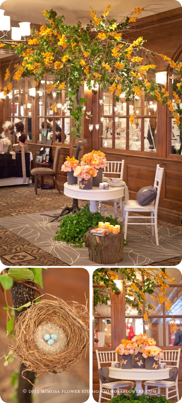 Mimosa Flower Studio - Custom Metal Tree covered with foliage and orange mokara orchids at Vintage Hotels Wedding Show 2012