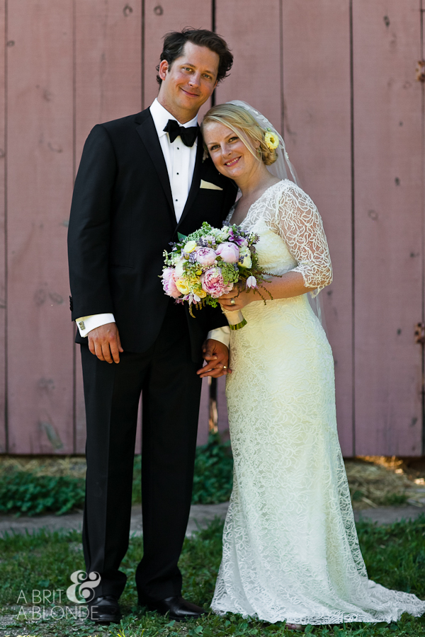 Bride and Groom on horsefarm with lace dress and tuxedo