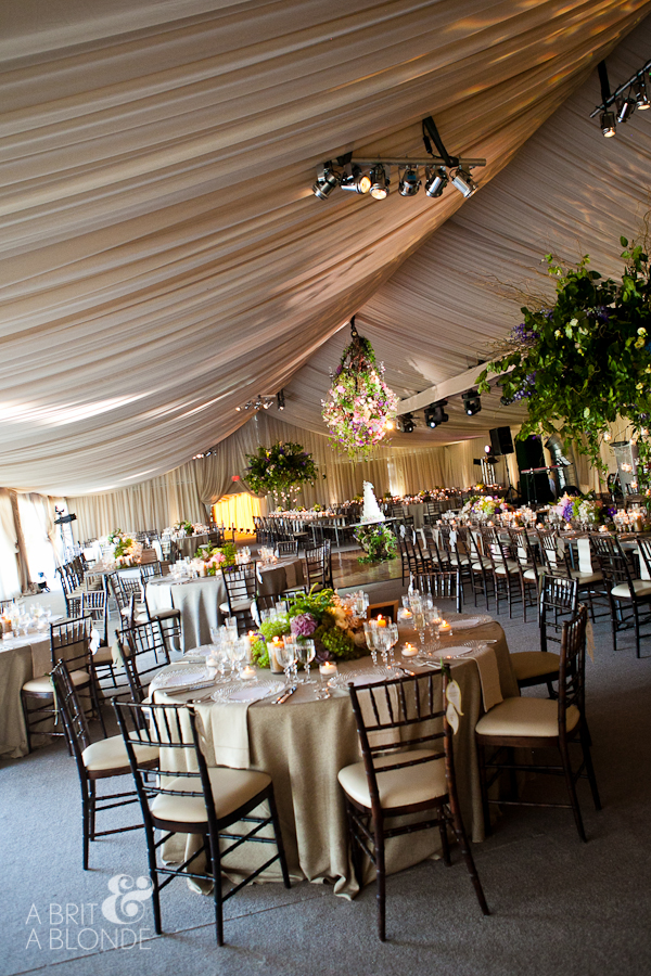Outdoor wedding reception in giant tent