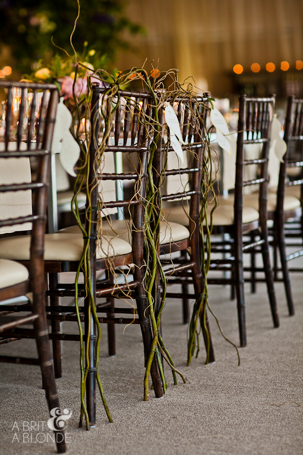 curly willow tied to chiavari chairs