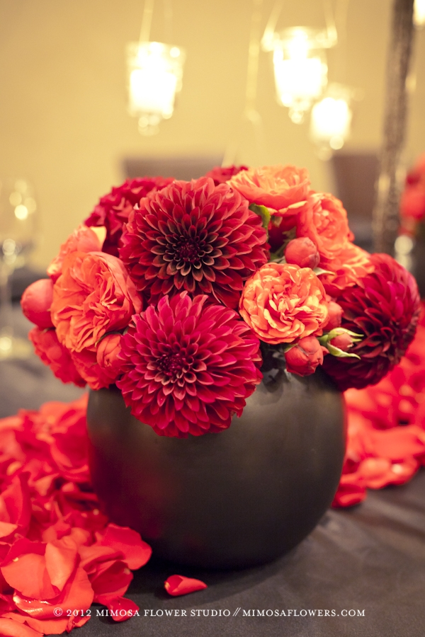 Red dahlias in a black ceramic egg container at Inn on the Twenty