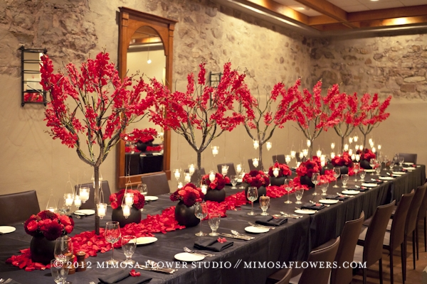 Red mokara orchids at wedding reception in Vintner's Cellar at Inn on the Twenty