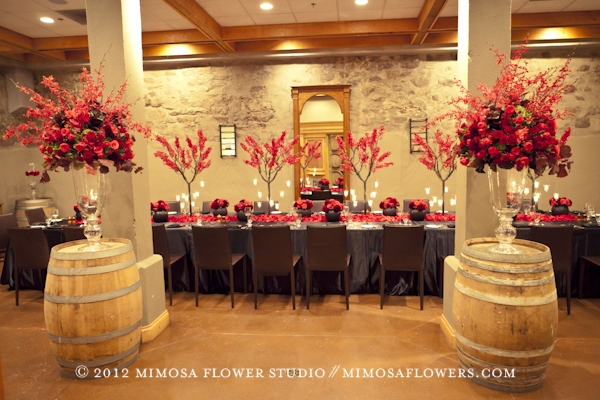 Red orchids, red dahlias, black linen at Inn on the Twenty