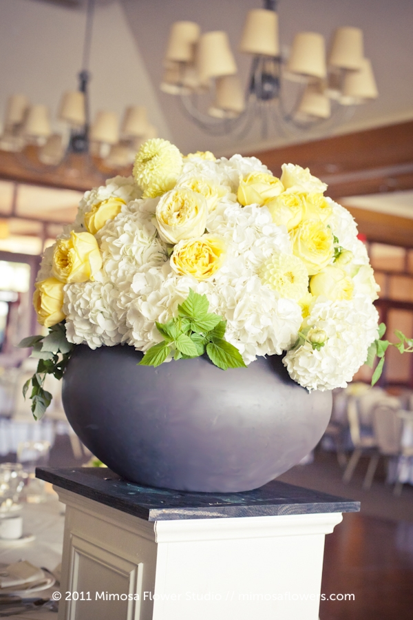 Yellow and white wedding altar flowers