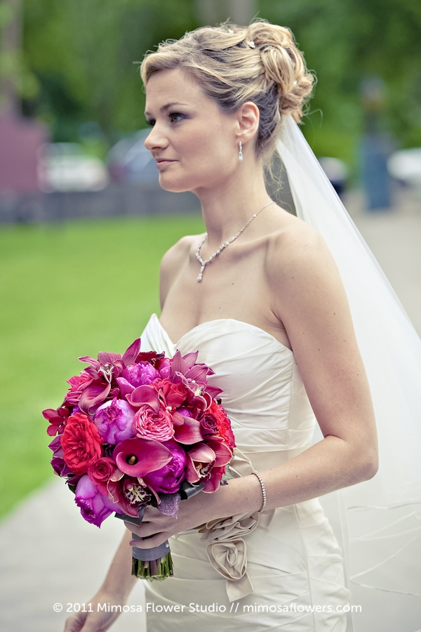 Bride with red and pink bouquet at St. Mark's Church
